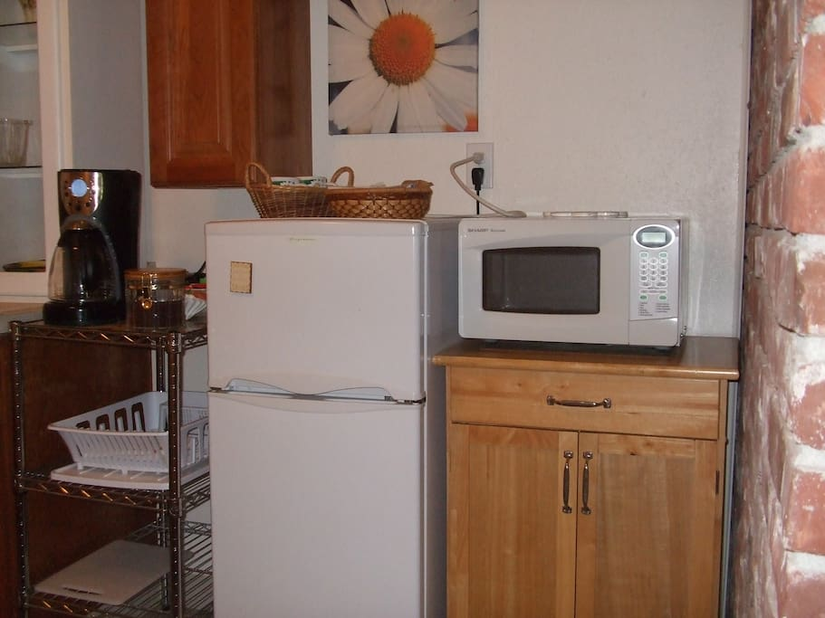kitchenette with sink, frig, coffee maker and micro