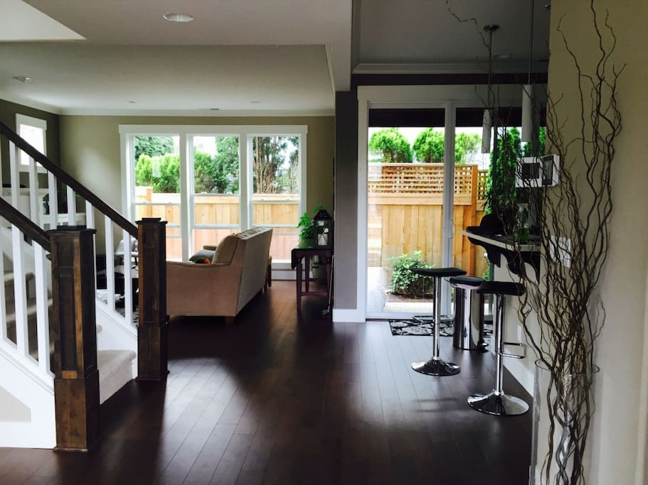 Entryway to open floor kitchen, dining and living room - modern design