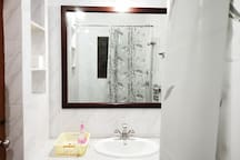 Master Bathroom with mirror and shelf