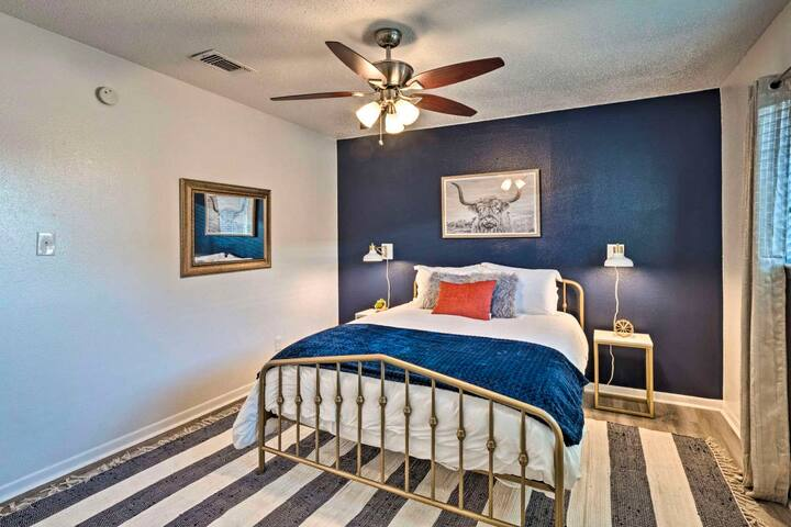 Bold navy & gold accents make the master bedroom pop!