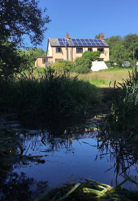 Self contained annexe in 3 acre plot with stream