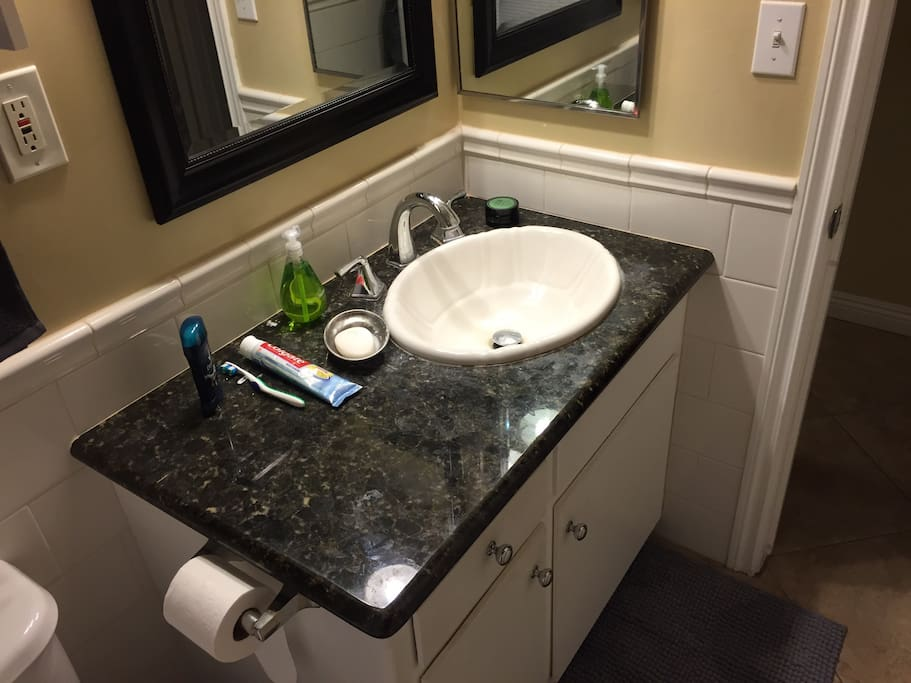 Small bathroom w/ a hot shower and fresh towels.