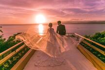 Exchange vows against the backdrop of the glittering infinity pool framed against the most dramatic sunset view in Bohol.