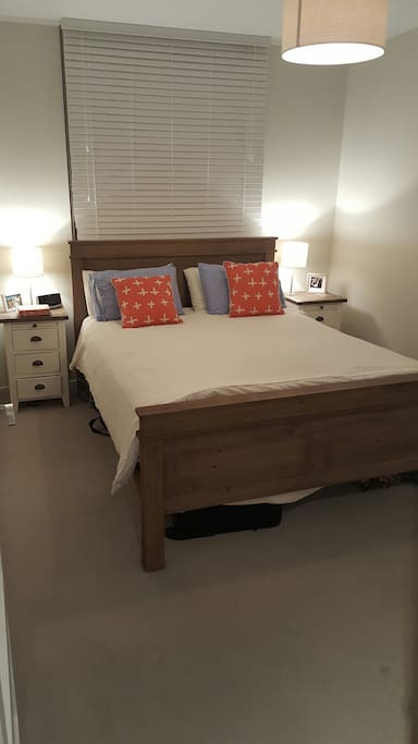 Large bedroom with Queen bed and air con