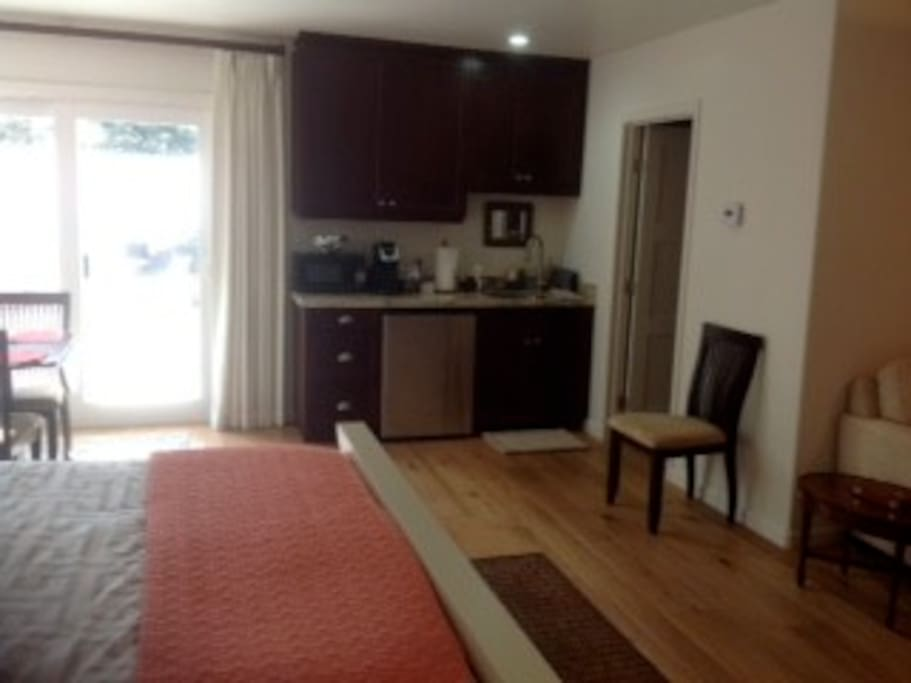 Kitchenette area with microwave, refrigerator,coffee maker, toaster and beautiful dishware!
