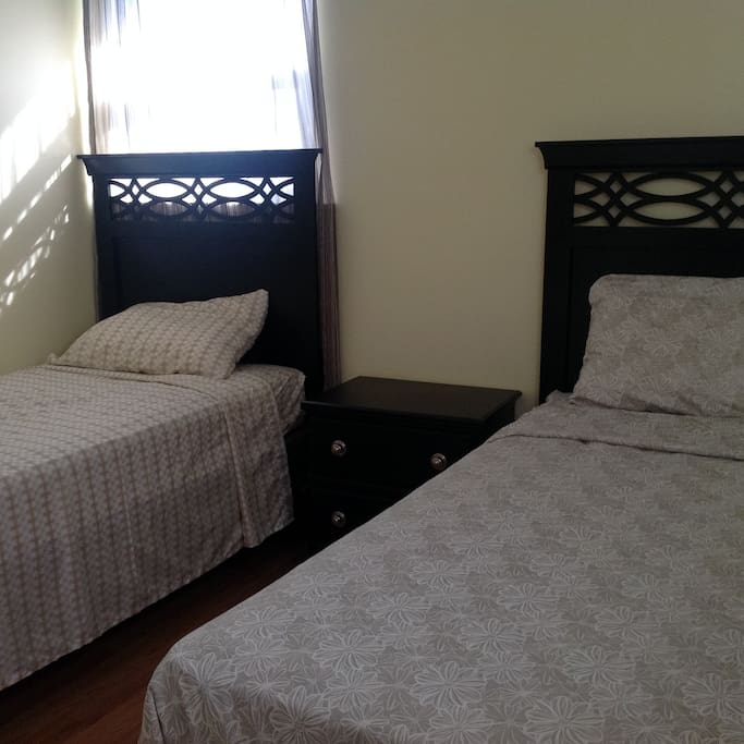 Two twin beds in 2 bedrooms