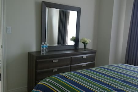 Only 20 min from Niagara Falls, stay with us in a  new built home 2015,  in a green area, beautiful home, spacious bedroom, pillow top-mattresses, queen-size,  en-suite bath. Everything is new and fresh.  A delicious Breakfast included.  By your request, we will provide  A special Honeymoon Package or Re-new your honeymoon to enjoy Niagara Trip with our RED LTD77.  Do not forget to Try our Indonesian food by your order. We are in Canada, 5 min from the US Border.