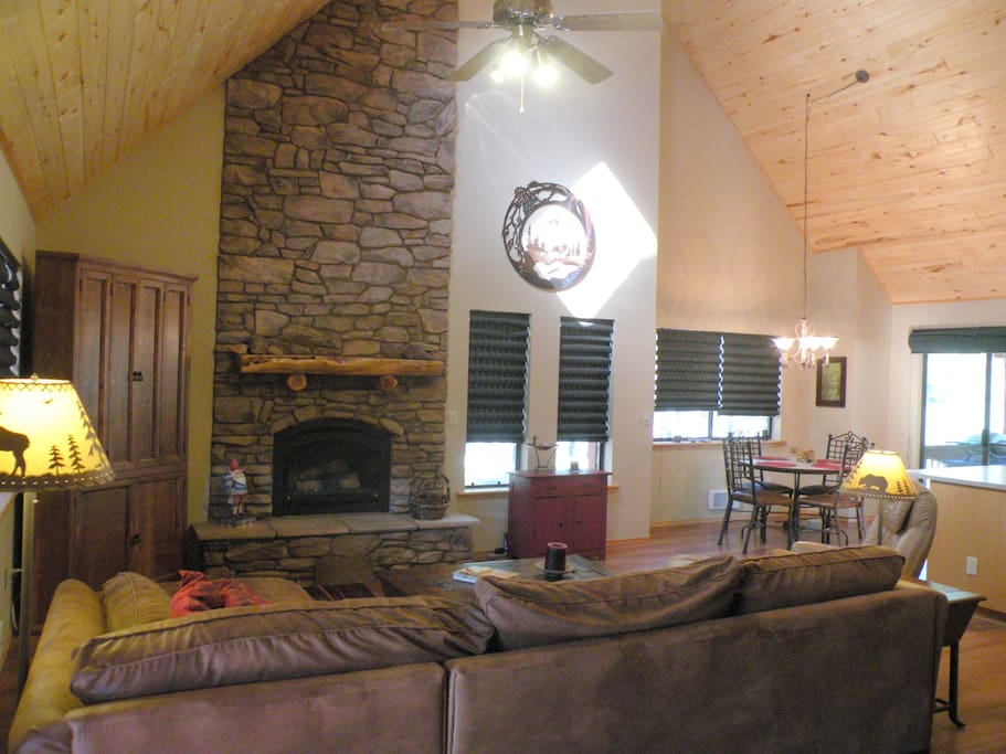 Great room with grand fireplace, aspen ceiling and 2 skylights.