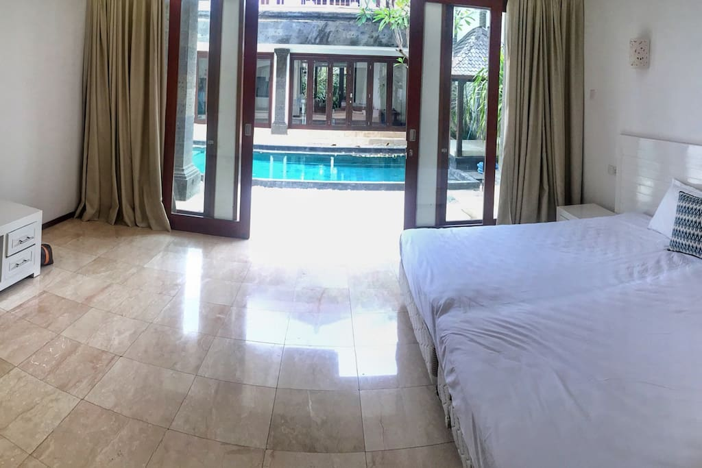 Your huge bedroom just by the swimming pool