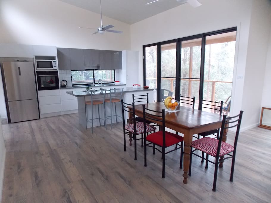Kitchen and dining- space; high ceilings and fans in every room keep the house cool even on the hottest days.