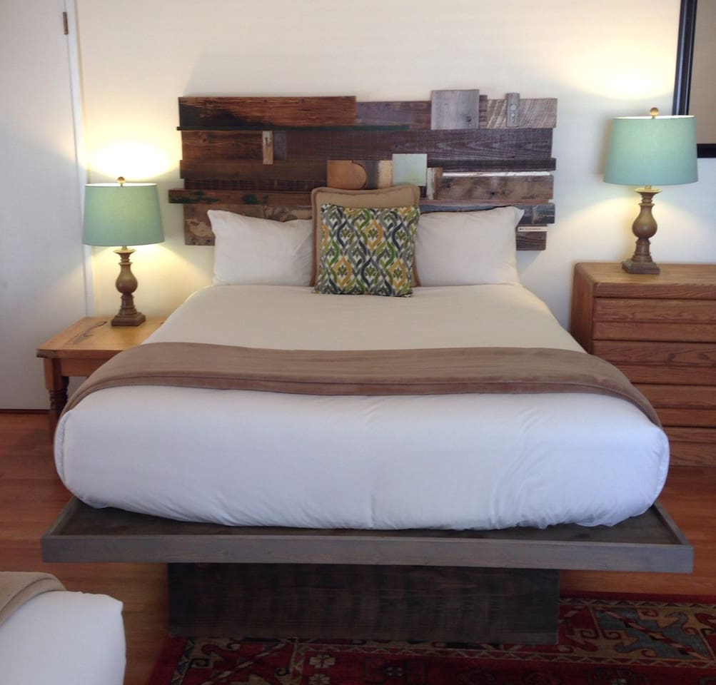 This room has two queen beds and is beautifully decorated