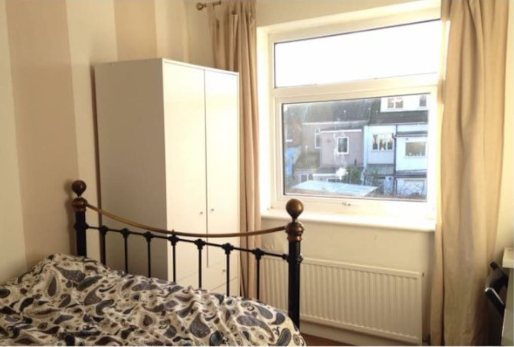 Guest room, with double bed, wardrobe & desk