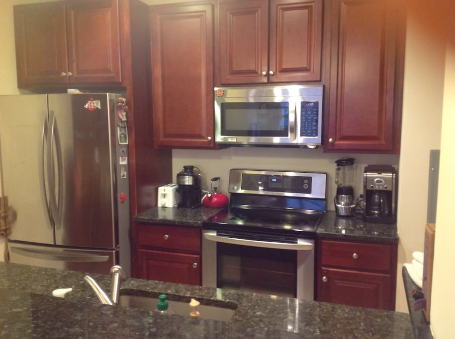 Fully equipped kitchen with a breakfast bar.