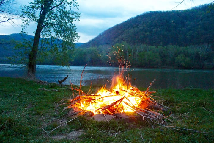 Enjoy a campfire by the river.