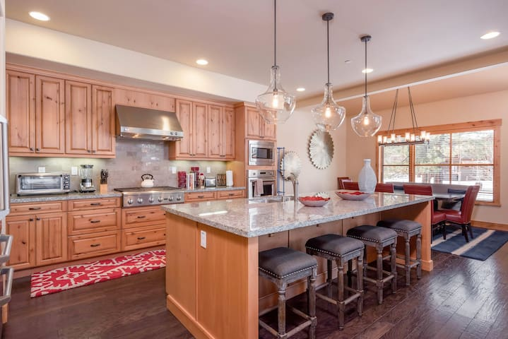 The showstopping kitchen includes a huge breakfast island that seats 4.