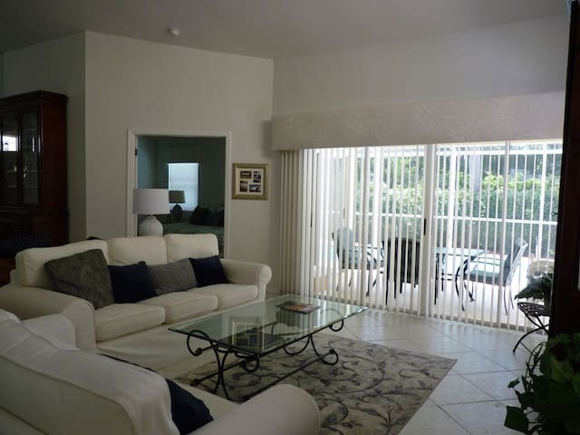 livingroom with view to pool area and masterbedroom