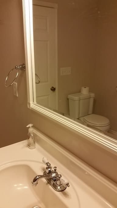 Spacious full bathroom with a clawfoot tub/shower.