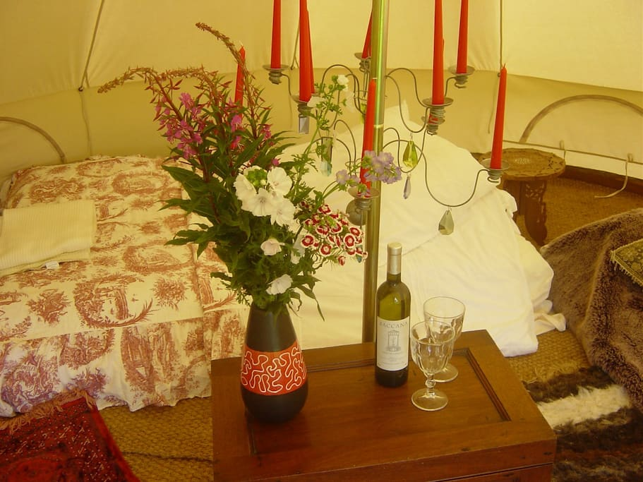 Bell tent with wildflowers ready for a romantic stay