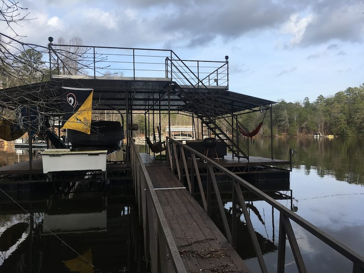 Our dock has a couch and two chairs on the lower level and a swing. There are beach chairs hanging that can be taken to the top of the dock. There is water on the dock that can be turned on at the house. There is also a fan if it gets too hot!
