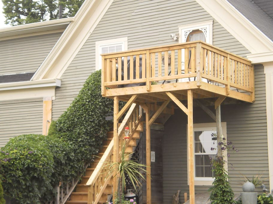 Relax on your own private deck overlooking the garden and river.