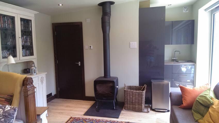 The Dovre wood burner and L shaped kitchen