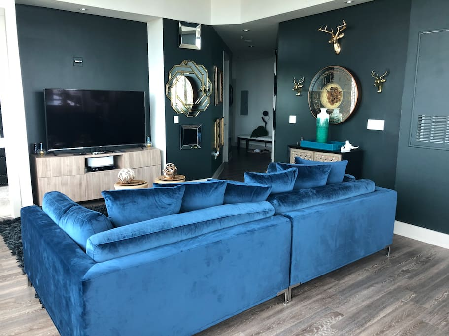 Living room space. Dark green wall with a blend of blue to give you a luxury feeling.