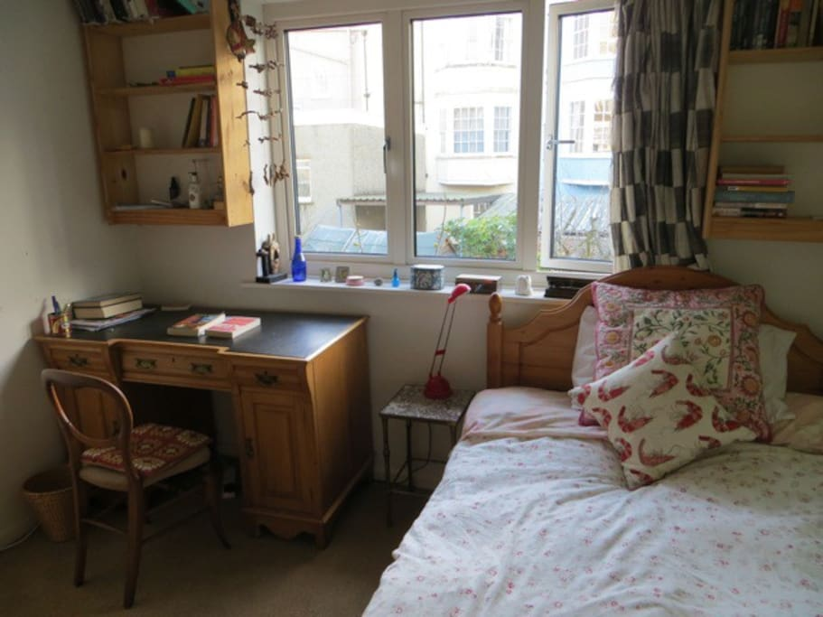 Cosy room for one with desk shelves, easy chair...
