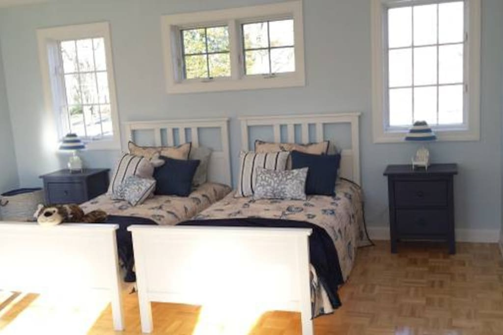 All new, bright and welcoming! 2 twins for King with add'l daybed that can be twin or King