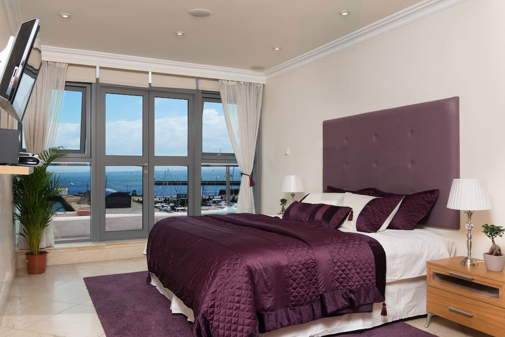 Master Suite Super King size bed with views of the Harbour & Galway Bay