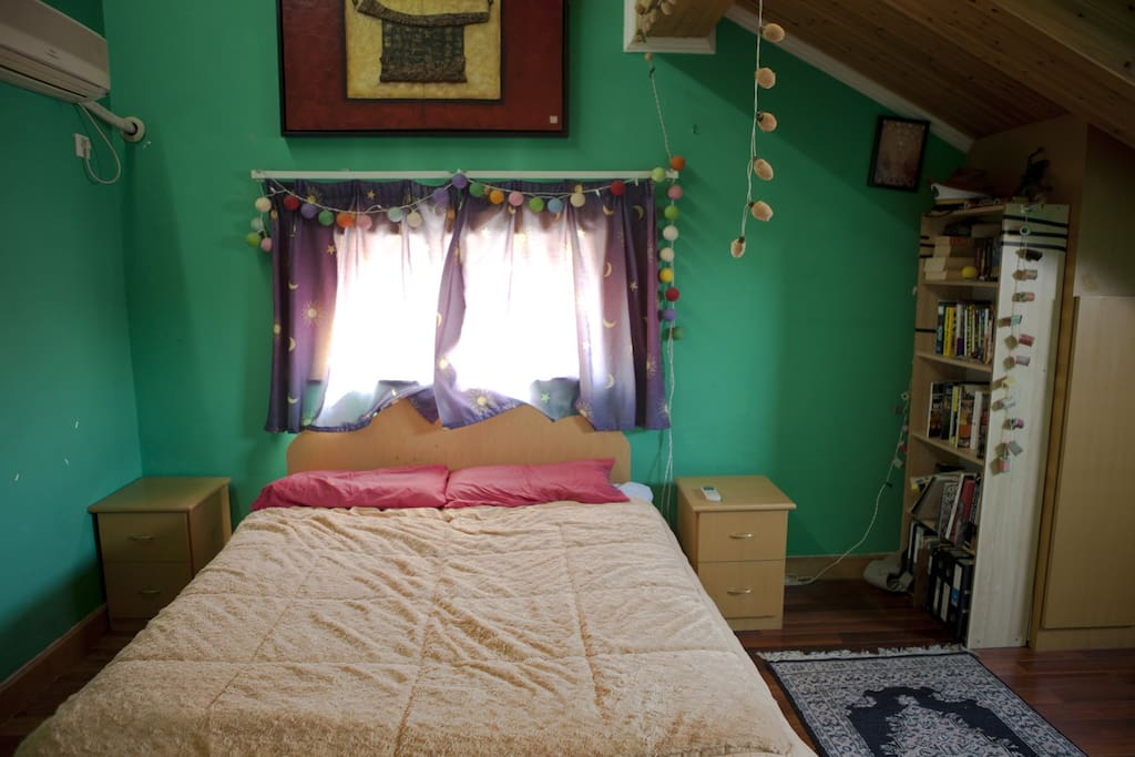 Your room is spacious, cozy and a little eccentrically decorated and lit...
