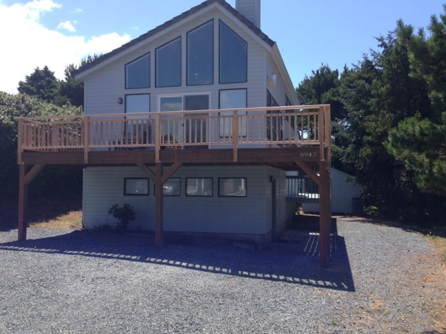 Lots of light in this two story (4 levels inside) contemporary home with wrap around front deck.  4 parking spots!
