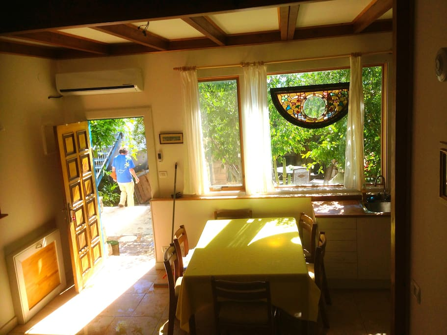 View of the dining table with garden behind