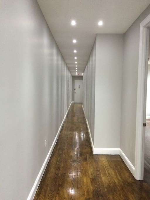 Very large hallway.  All three bedrooms are on the right.  Master bedroom has ensuite bath.  Other bathroom sits between the two smaller rooms.  Second bedroom has twin size bed with flat screen tv.  Third bedroom is kids bedroom with bunkbeds.