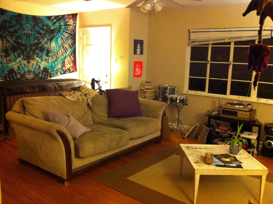 This is part of the living room, featuring a comfy couch, a vinyl record player, various instruments (a 4 octave marimba)