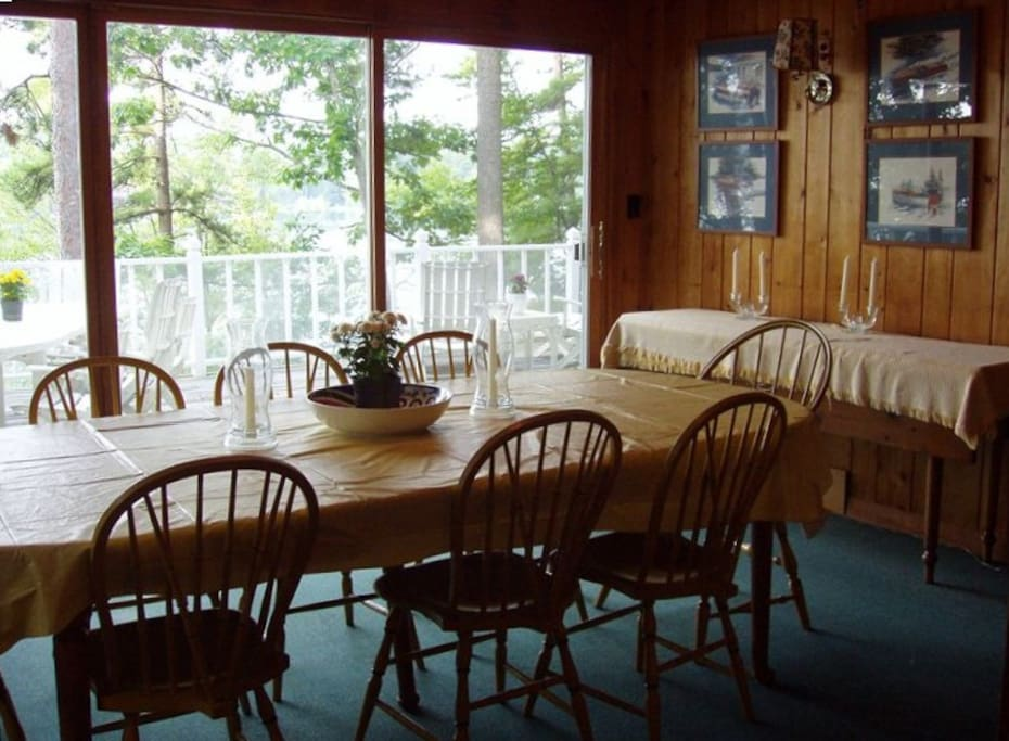 The dinning room seats 10 and overlooks deck and harbor
