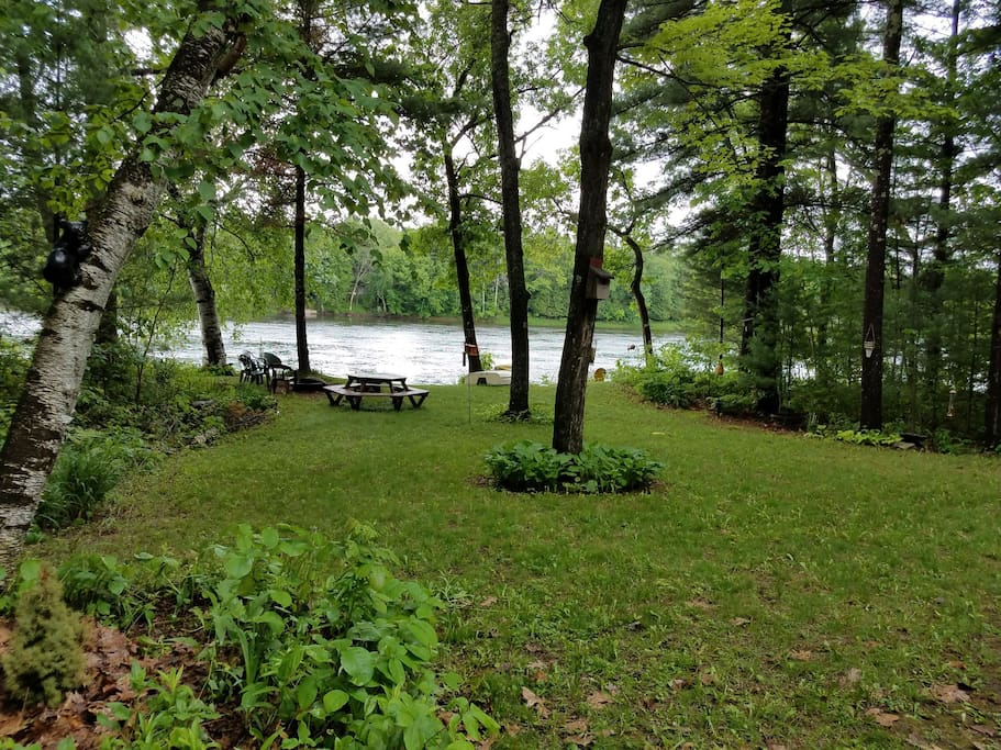 View from back deck. There is a second fire pit back by the river