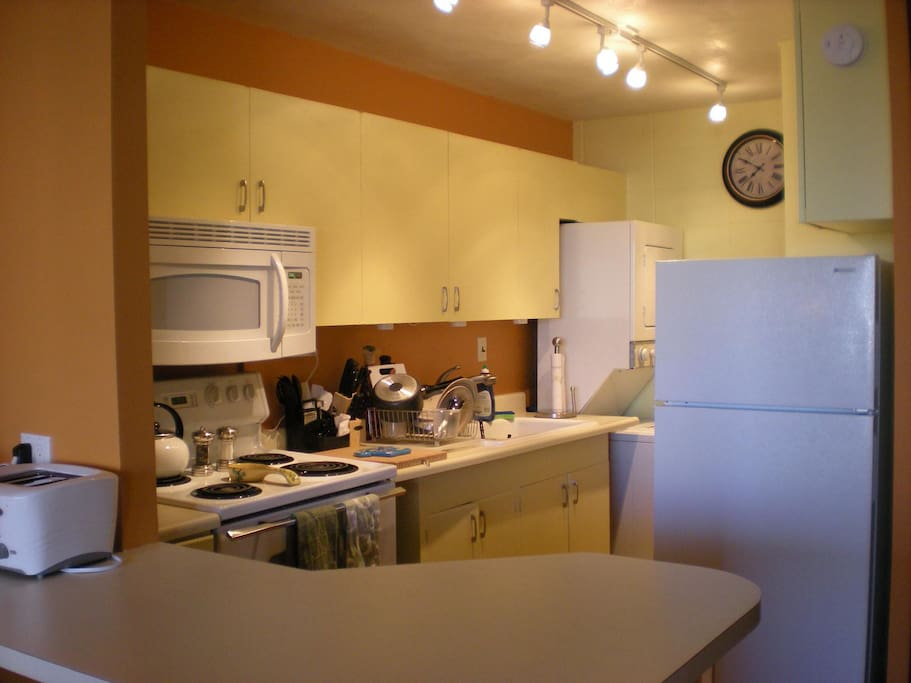 Full kitchen with washer and dryer.