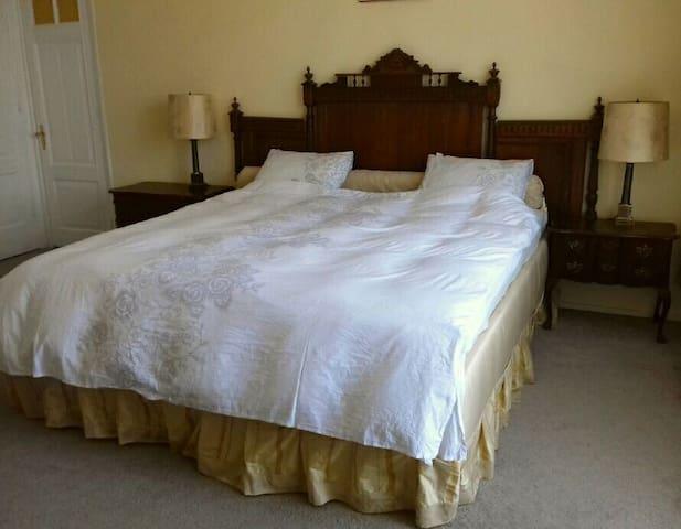 Luxury golden bedroom in the center