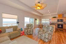 Comfortable living room with bay views from the windows