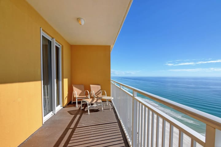 Gulf views from the living room of this waterfront condo plus shared pool & gym