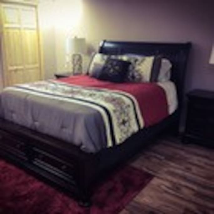 14x24 private bedroom with queen size bed, drawers under the bed and 2 closets with plenty of hangers. There is separate entrance thru garage into your room. Plus a full size bathroom all to yourself on this floor. Heated floors are a plus in this room.