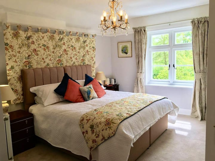 SuperKing bedroom with garden view and river