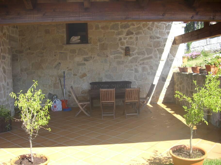 Terraza con porche oeste