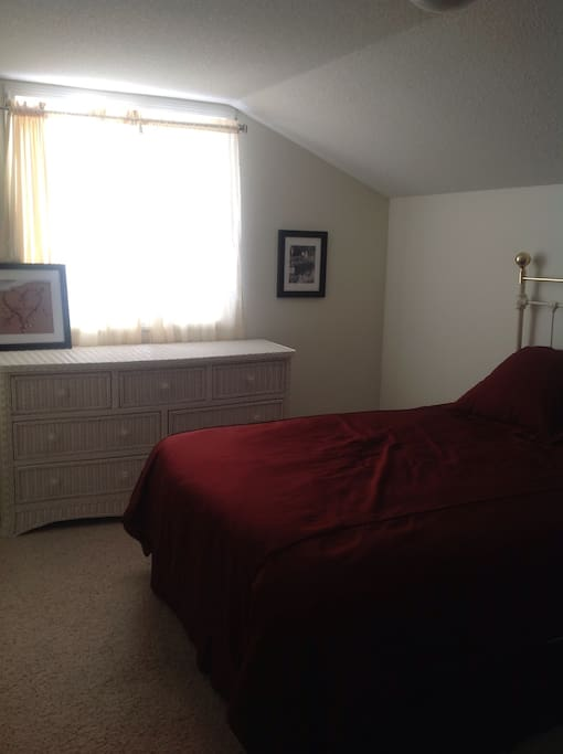 Upstairs bedroom with private bath.