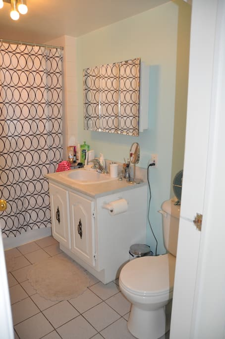 Clean, and renovated bathroom with tub.