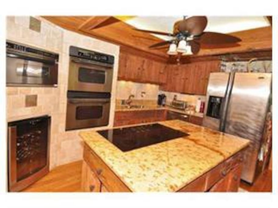 Kitchen,  stainless steel appliances and built in wine fridge, double ovens.