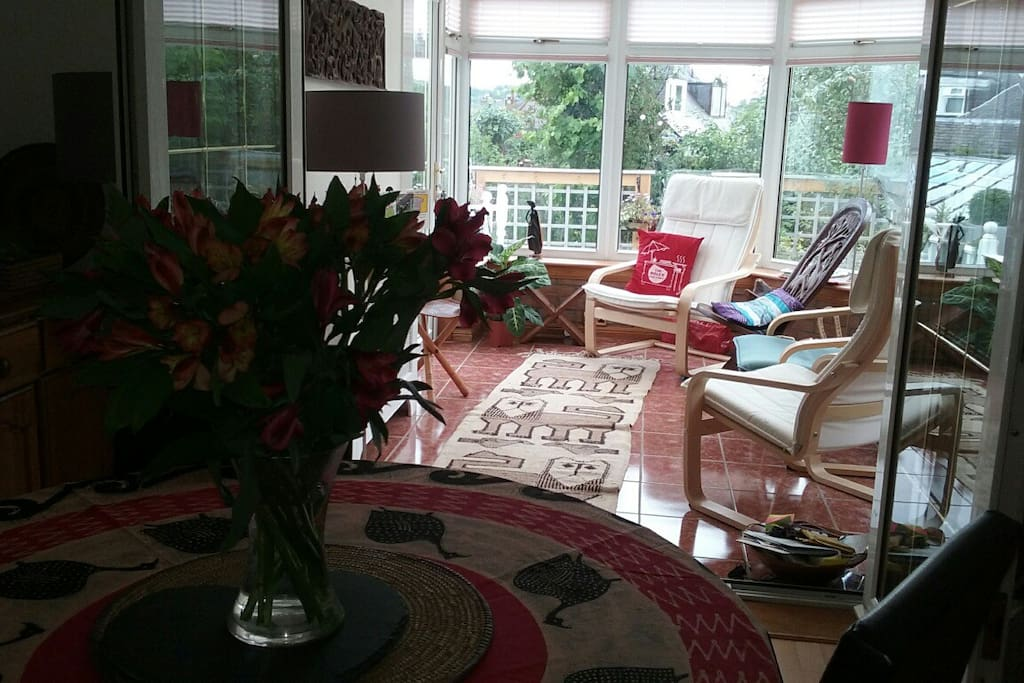 Dining room and conservatory. Access to sunny garden