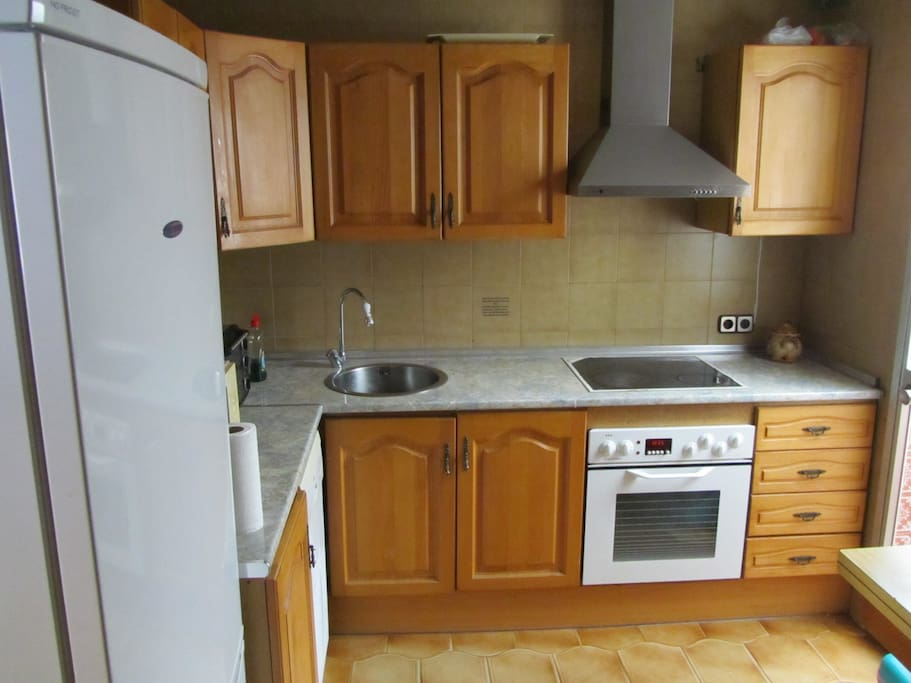 This is the kitchen which you can use. There is a hob, oven, fridge, freezer and microwave. Plenty of Pots and Pans.