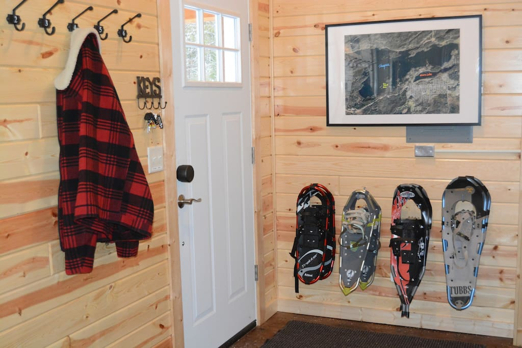 Front entry with a map of Shagawa Lake and snowshoes for four guests
