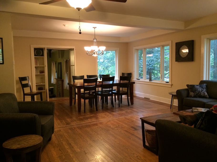 Living room w/ adjoining dining area.